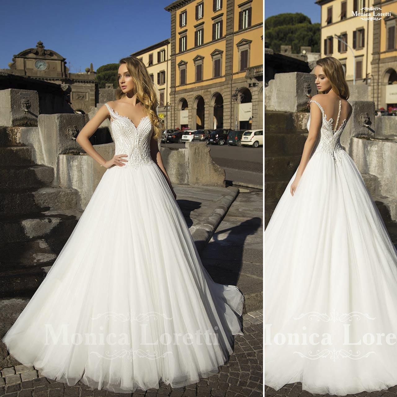... Abito da sposa principessa articolo Olivo Monica Loretti Bellissimo  abito da sposa in pizzo bianco dallo stile moderno articolo Maricel ... b840372c5a6